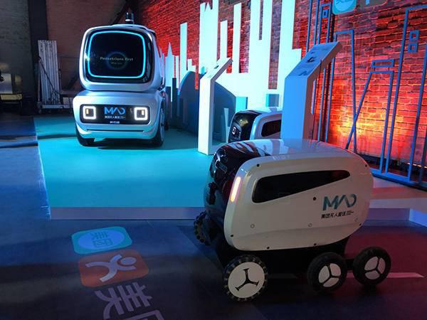 左:可在城市道路低速自动驾驶的无人配送车;右:主要用于园区内送外卖的无人车